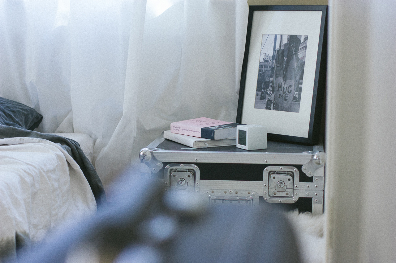 Books on bedside table by Conscious by Chloé