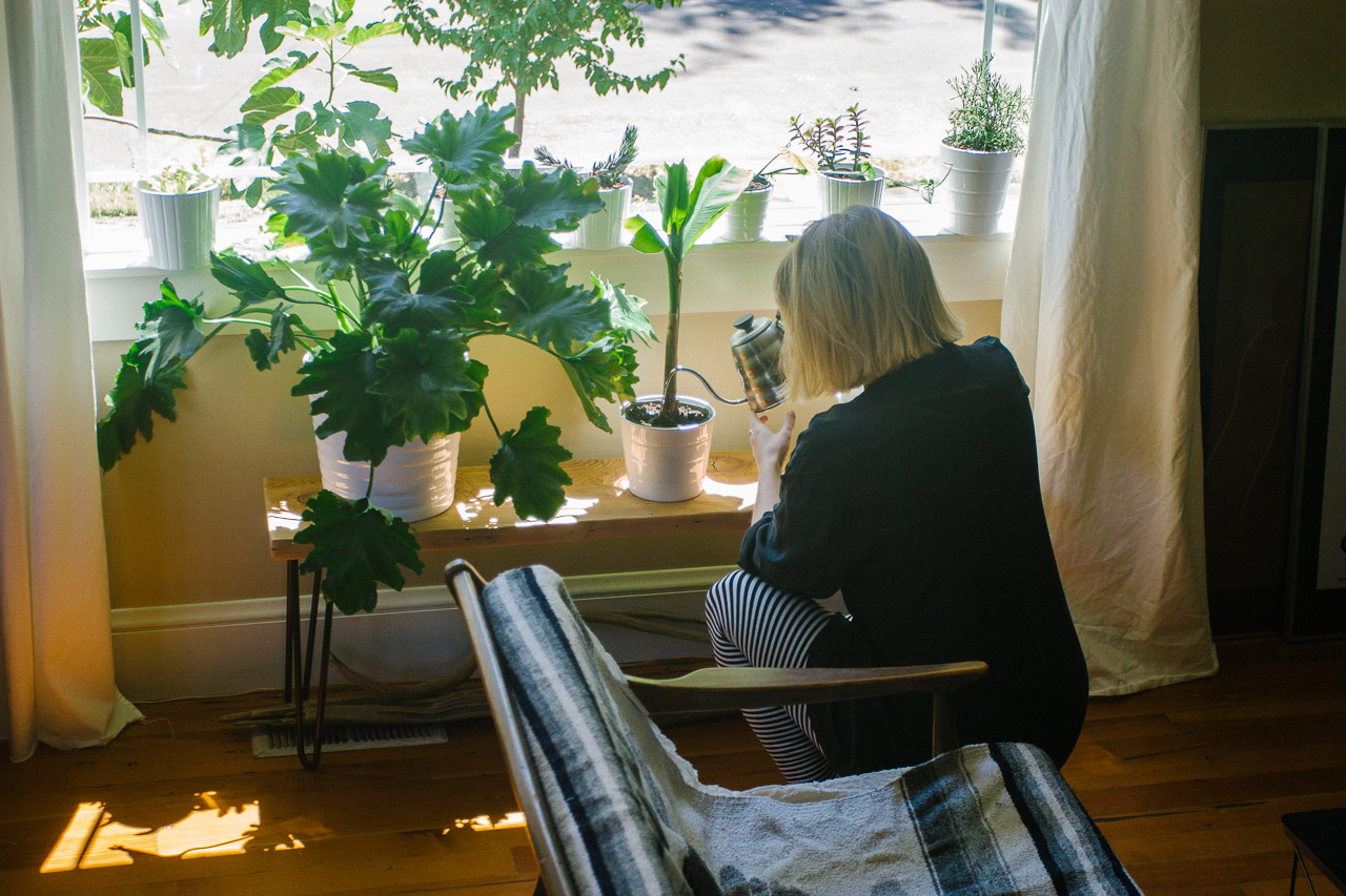 Watering plants by Conscious by Chloé